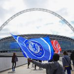 LONDON, UNITED KINGDOM - MAY 14:  A Chelsea fan waves a flag outside the stadium prior to the SSE Women's FA Cup Final between Arsenal Ladies and Chelsea Ladies at Wembley Stadium on May 14, 2016 in London, England.  (Photo by Ben Hoskins/Getty Images)